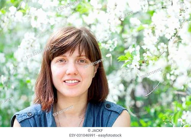 portrait of girl in spring blossoming garden