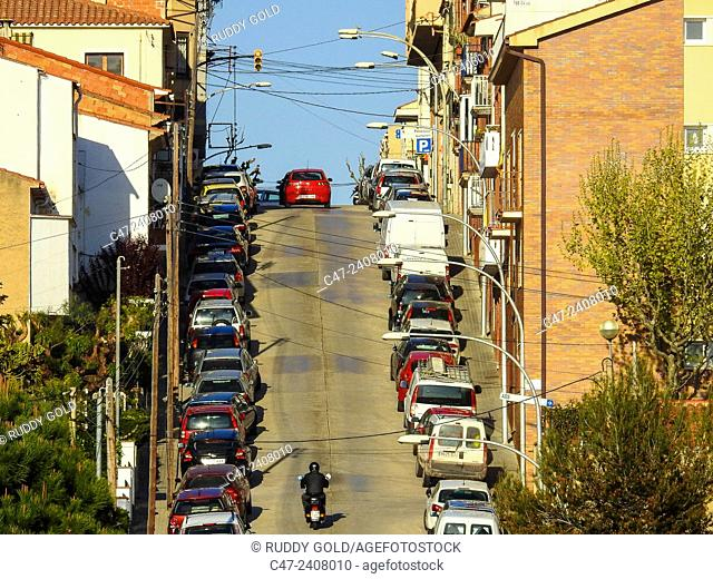 Parked cars in an inclined street. EL Masnou, Maresme, Barcelona province, Catalonia, Spain