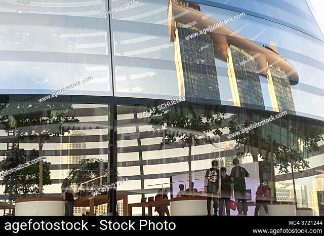 Singapore, Republic of Singapore, Asia - Looking inside the new Apple Flagship Store along the waterfront at Marina Bay Sands