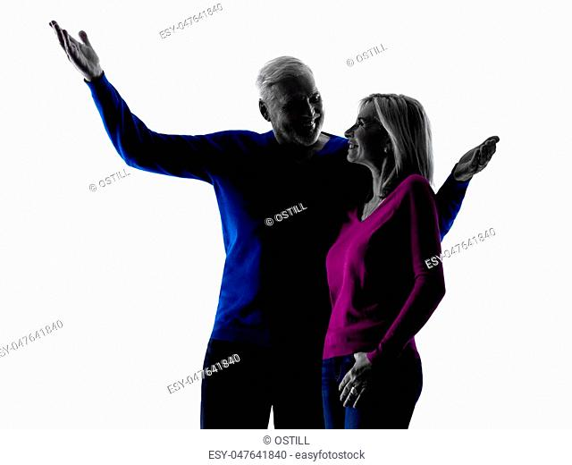 one caucasian couple senior happy pointing silhouette in silhouette studio isolated on white background