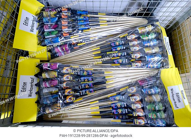 28 December 2019, North Rhine-Westphalia, Eitorf: Firework rockets are lying in a basket at the factory outlet of the fireworks manufacturer WECO