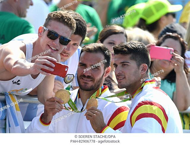 Gold medalists Saul Craviotto and Cristian Toro (R) of Spain pose for a selfie after the Men's Kayak Double 200m final of the Canoe Sprint events of the Rio...