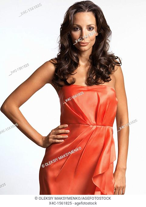 Fashion photo of a Beautiful woman wearing a red dress  Isolated on white background