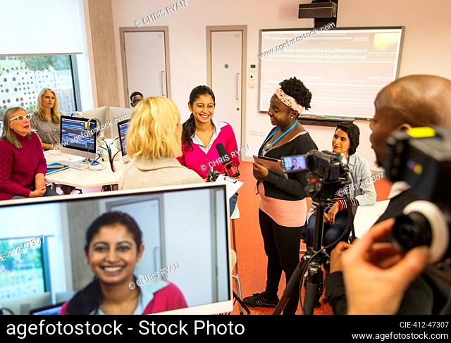 Community college students filming in media classroom