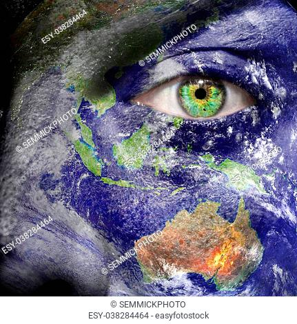 Oceania painted on face with green eye to promote a better world