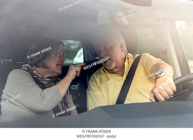 Couple inside car arguing