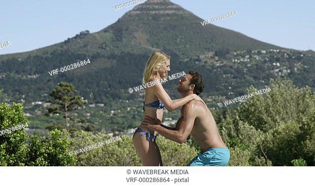 Man carrying woman