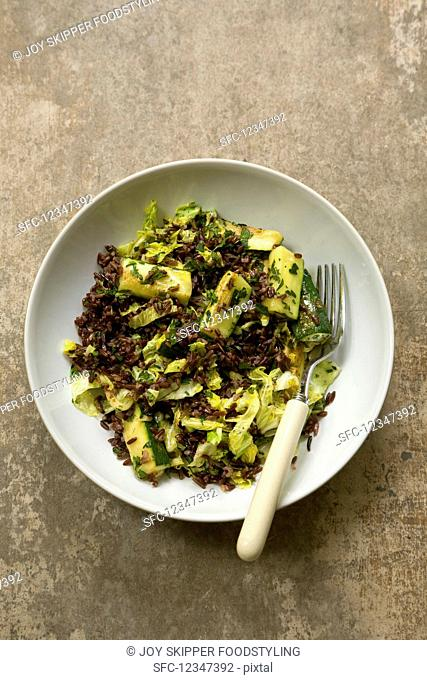 Red rice, zucchini, and white cabbage salad