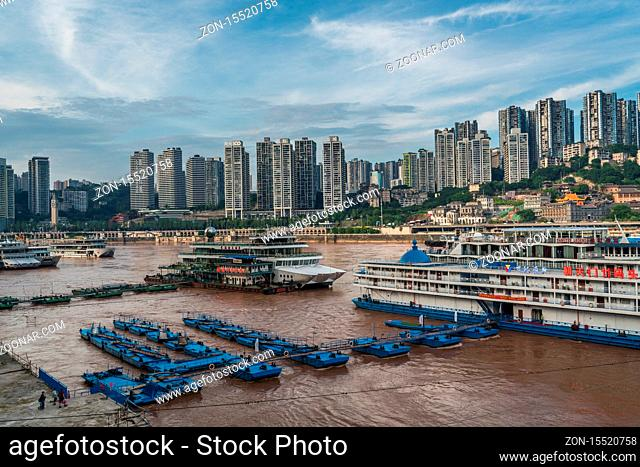 Chongqing, China - August 2019 : Luxury passengers cruise ships ready to depart from Chongqing wharf on a trip through the Three gorges on the Yangtze river in...