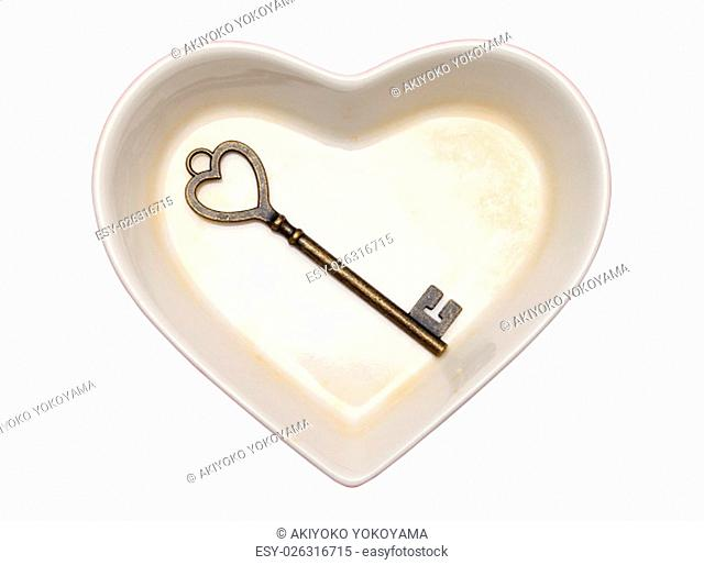 vintage key and heart shape plate isolated on white background