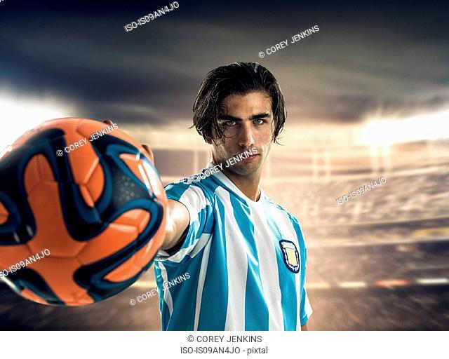 Footballer holding ball