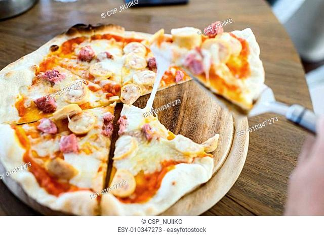 Take out sausage pizza from chef. Ready to serve