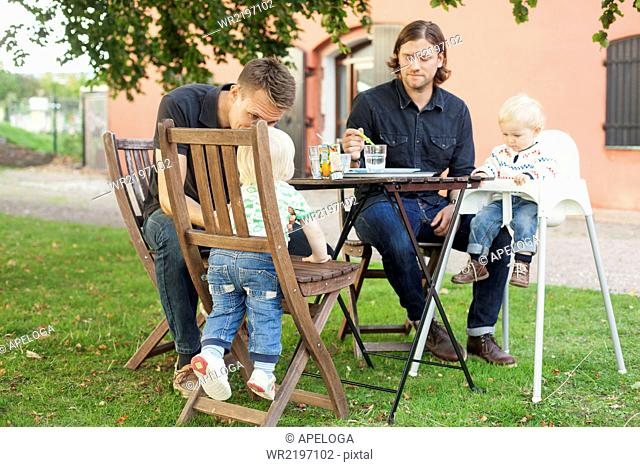 Fathers having breakfast with children at park