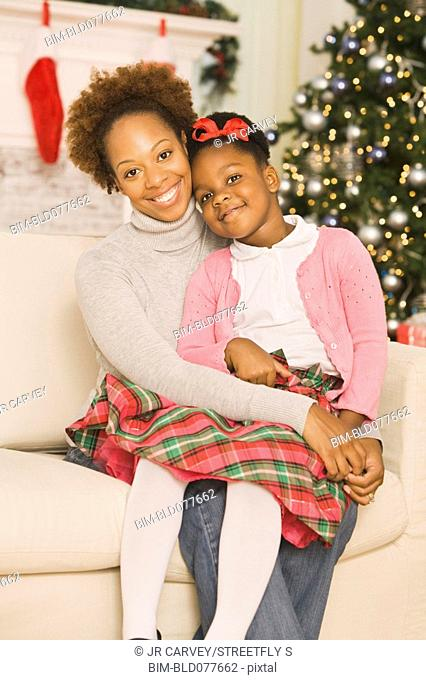 African mother hugging daughter at Christmas