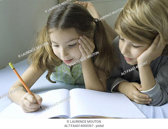 Two children doing homework together
