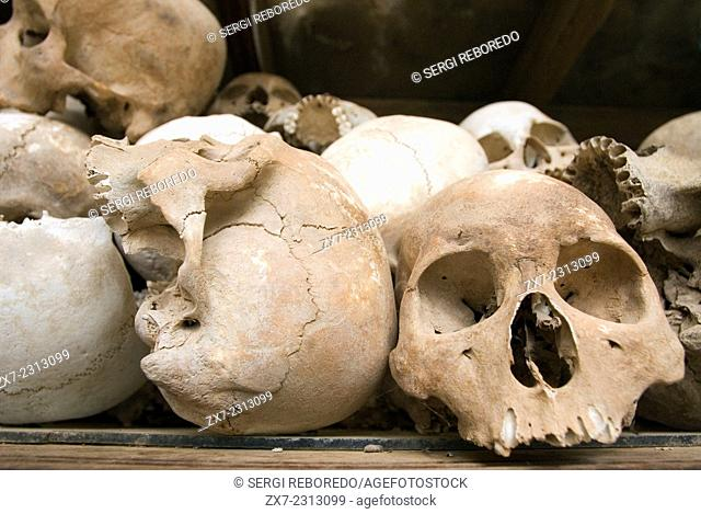 "Skulls in """"Killing Fields of Choeung Ek."""" Phnom Penh. The best known monument of the Killing Fields is at the village of Choeung Ek"