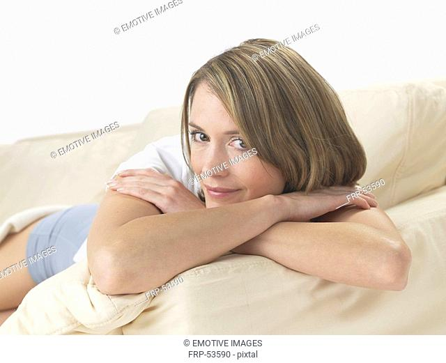 Woman lounging on a sofa