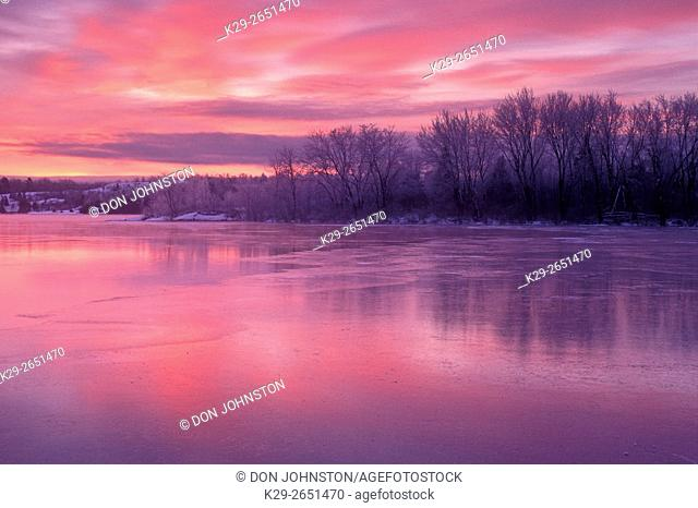 Dawn sky reflected in frozen Vermillion River, Whitefish, Ontario, Canada