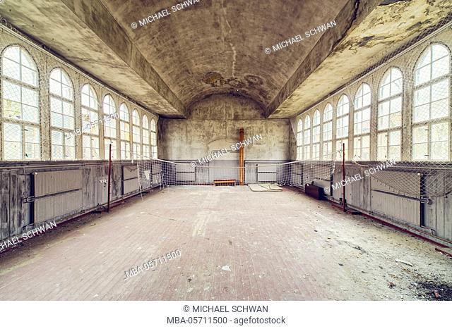 derelict gymnasium in a hospital with volleyballnet