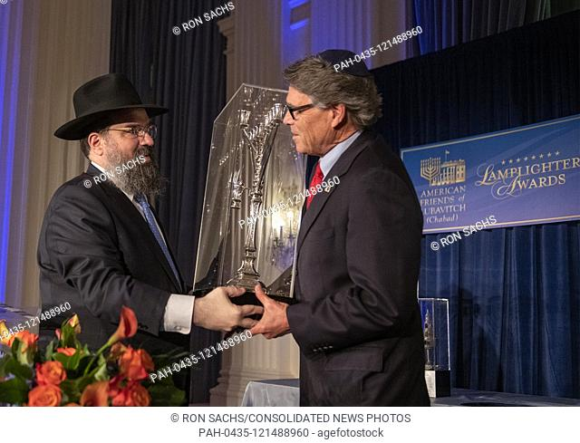 United States Secretary of Energy Rick Perry, right, accepts the 2019 Lamplighter Public Service Award from Rabbi Levi Shemtov