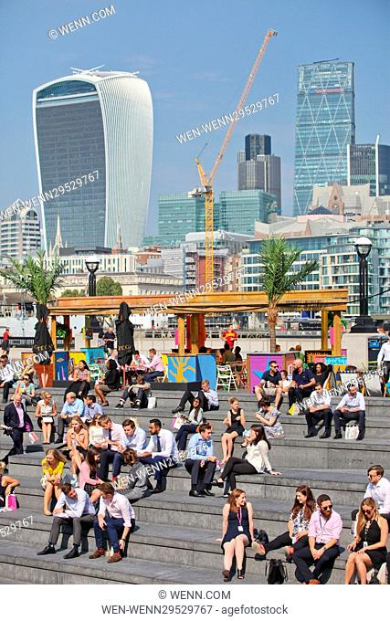 People enjoying the warm sunshine and hot weather on London Riverside, near City Hall. Featuring: Atmosphere Where: London
