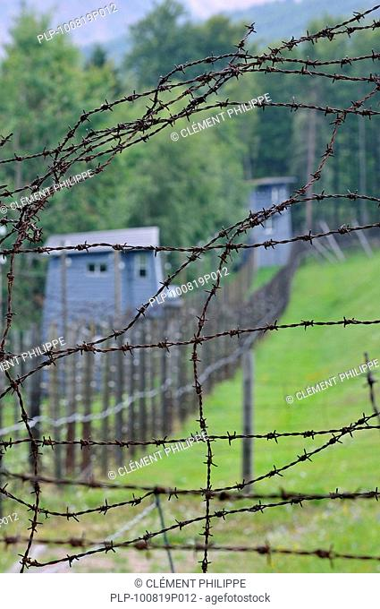 Barbed wire fence and watchtowers at Natzweiler-Struthof, the only concentration camp established by the Nazis on French territory, Alsace, France