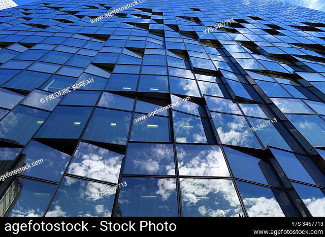 View of reflections in the glass windows of a building in Osaka, Honshu, Japan, Asia