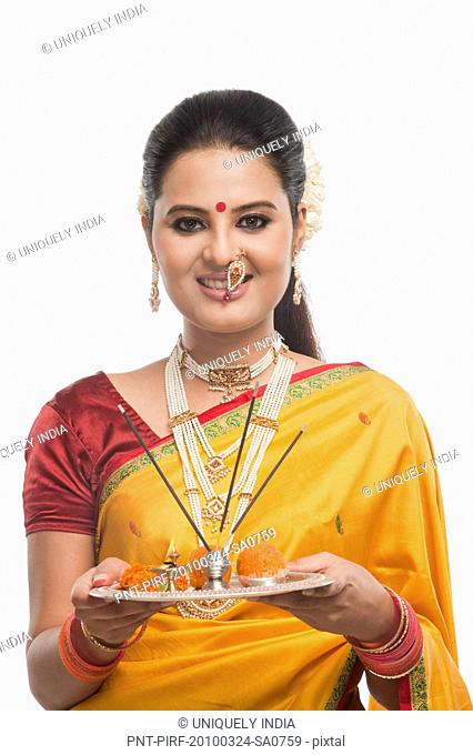 Portrait of a woman holding a plate of religious offerings on Gudi Padwa festival