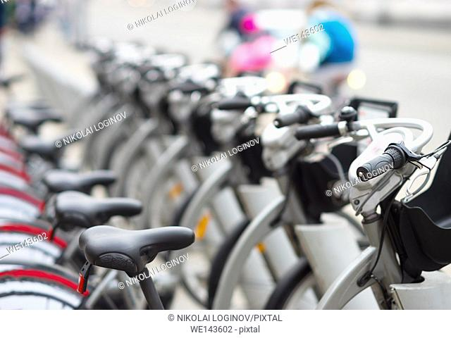 Diagonal bicycle row in street bokeh background