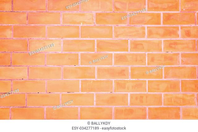 baked clay brick wall background, rough surface