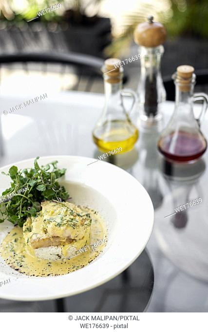 sea bream fish fillet in creamy mustard dill and lemon sauce restaurant meal on plate