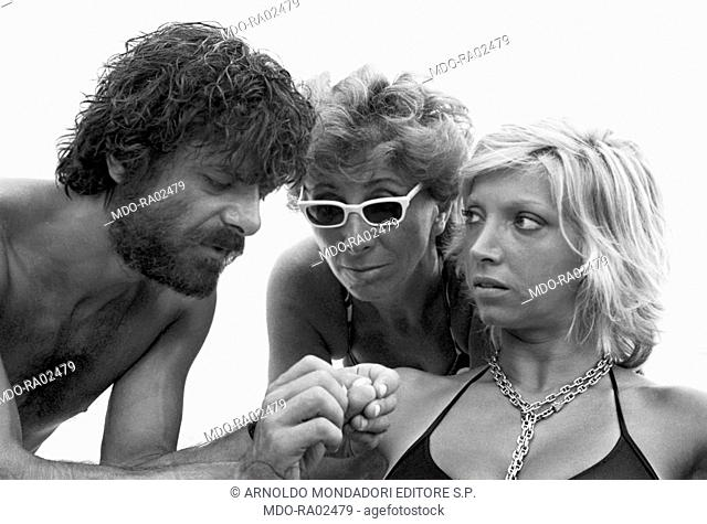 Italian director and scriptwriter Lina Wertmueller, Italian actor, director and scriptwriter Giancarlo Giannini and Italian actress Mariangela Melato discussing...