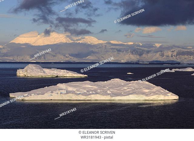 Early morning atmospheric cloud and mist, mountains, glaciers and icebergs, Neko Harbour, Andvord Bay, Graham Land, Antarctica, Polar Regions