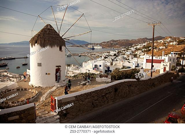 Tourists in front of the windmill on the hill above the town center, Mykonos, Cyclades Islands, Greek Islands, Greece, Europe