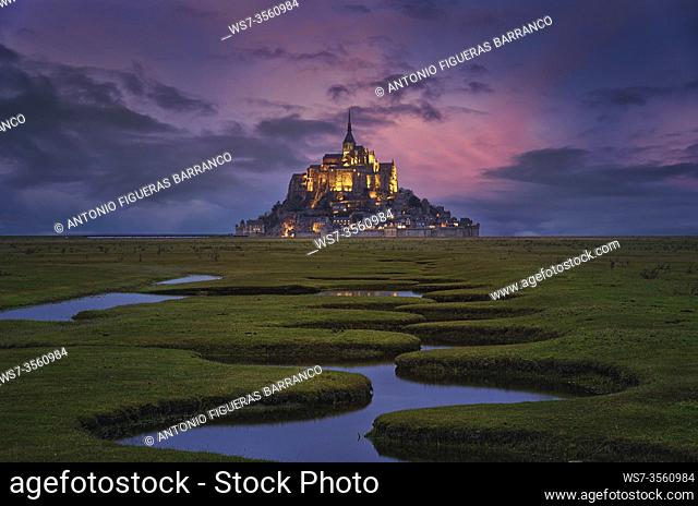 View of Mont Saint-Michel after sunset, from the meander of the adjacent fields