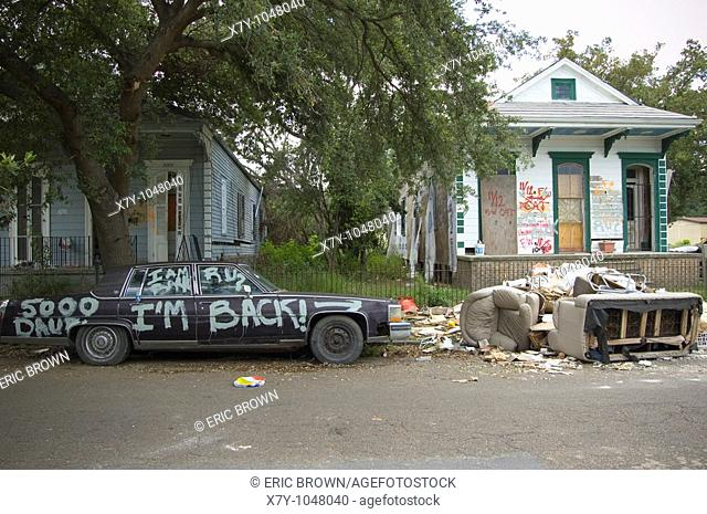 'I'm Back!' is painted upon a car outside some homes in the Lower Ninth Ward, New Orleans `