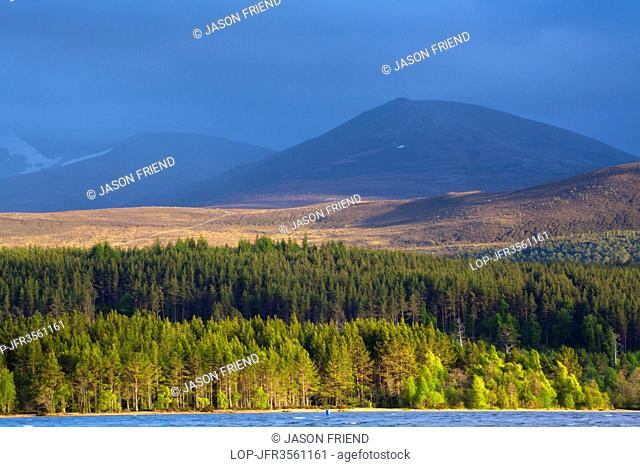 Scotland, Highland, Loch Morlich. A stormy evening over Loch Morlich with the Cairngorm Mountain Range in the distance