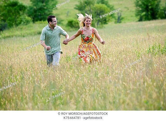 Running on top of hill in field