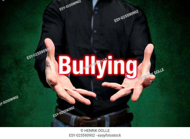 Young man holds lettering bullying in the hands