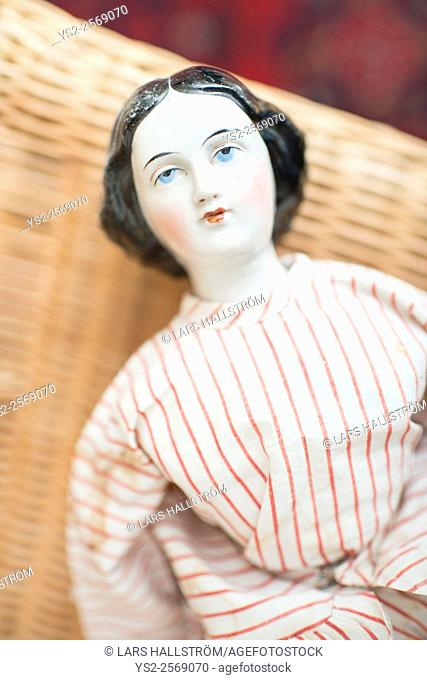 Pensive porcelain toy doll. Old fashioned retro design