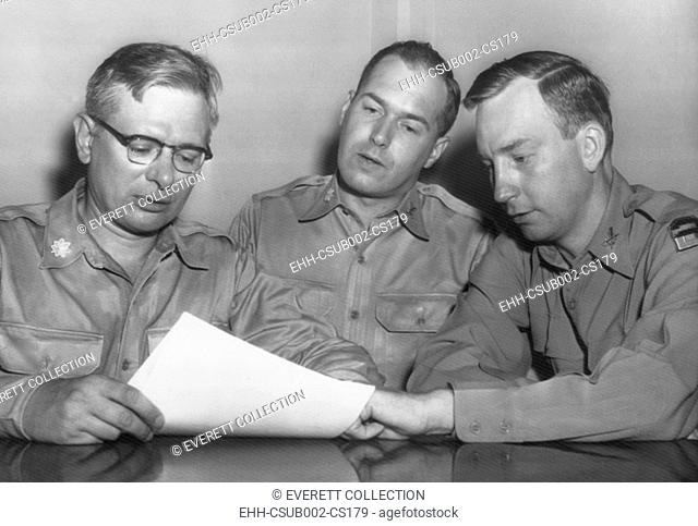 Major Roland E. Alley (center), a 14 year Army veteran, charged misconduct as a Korean War POW. August 22, 1955. His lawyer, Col. William T