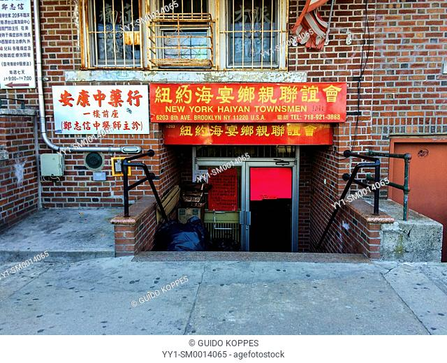 New York, USA. Facade and entrance of a Chinese store in Chinatown, Brooklyn
