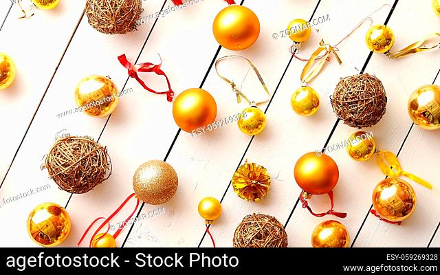 Christmas golden collection, balls and decorative ornaments, on white wooden background