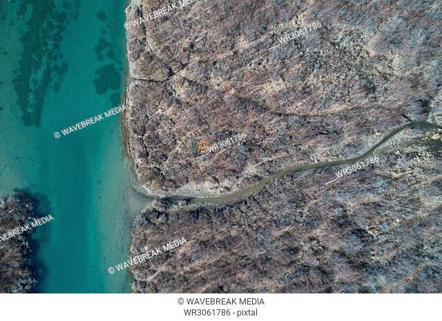 Aerial of rocky coast and river