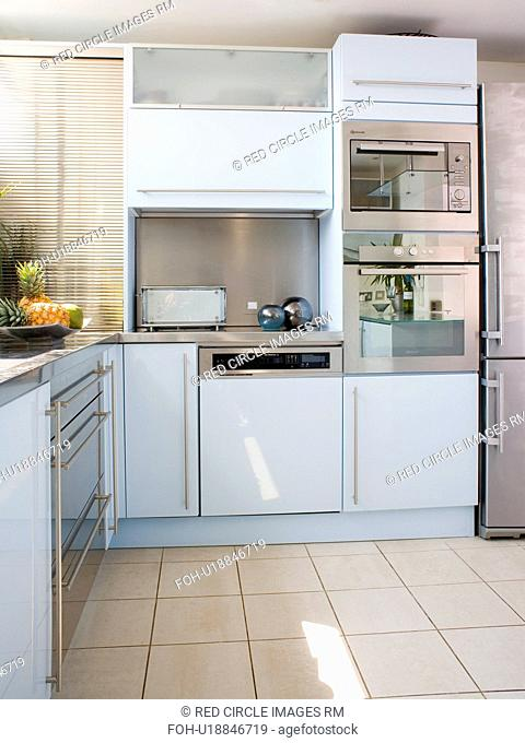 Stainless Steel Double Oven In Modern White Kitchen With Cream Ceramic Floor Tiles Stock Photo Picture And Rights Managed Image Pic Foh U18846719 Agefotostock