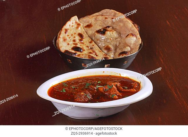 Indian meal , Chicken Curry and Roti bread