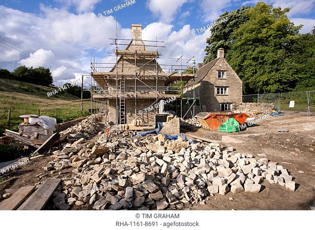 Home improvement, a renovation project restoring a 17th century Cotswold old stone cottage in Swinbrook in the Cotswolds, Oxfordshire, England, United Kingdom