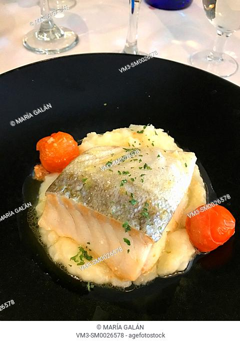 Codfish loin with garlic sauce and cherry tomatoes