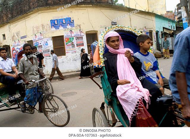 Traffic of Cycle Rickshaw Rider with  Passenger on street  at Dhaka ; Bangladesh