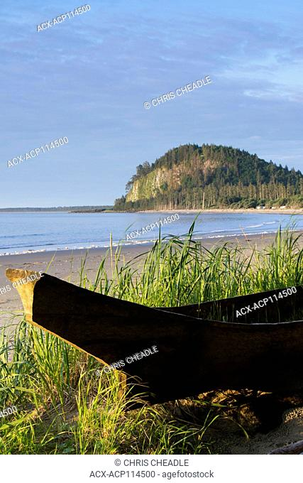 Haida dugout cedar canoe on Agate Beach, with Tow Hill shown, Haida Gwaii, formerly known as Queen Charlotte Islands, British Columbia, Canada
